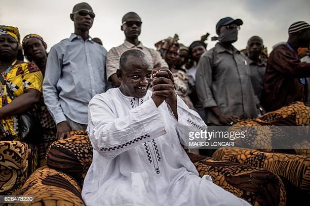 Adama Barrow the flagbearer of the coalition of the seven opposition political parties in Gambia greets supporters during a gathering in the buffer...