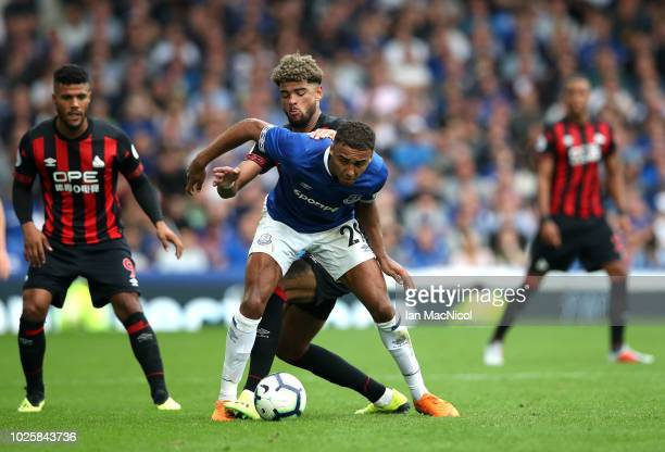 Adama Diakhaby of Huddersfield Town and Dominic CalvertLewin of Everton battle for the ball during the Premier League match between Everton FC and...