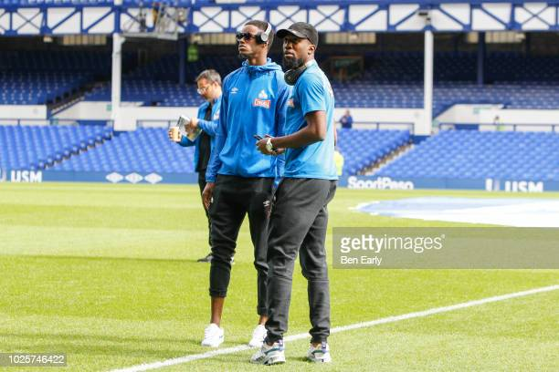 Adama Diakhaby of Huddersfield Town and Isaac Mbenza of Huddersfield Town inspect the pitch during the Premier League match between Everton FC and...