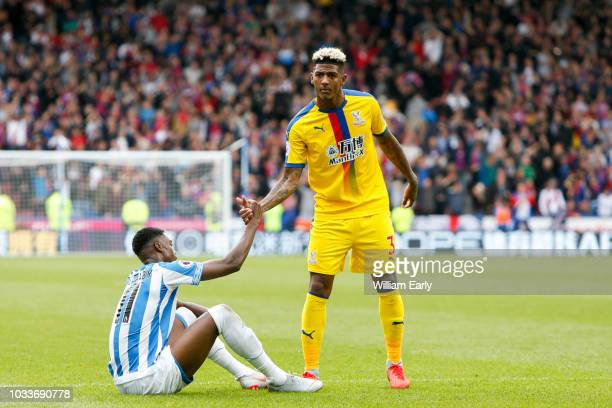 Adama Diakhaby of Huddersfield Town and Patrick Van Aanholt of Crystal Palace during the Premier League match between Huddersfield Town and Crystal...