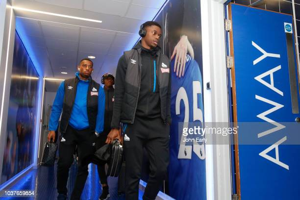 Adama Diakhaby of Huddersfield Town and Rajiv van La Parra of Huddersfield Town arrive before the Premier League match between Leicester City and...