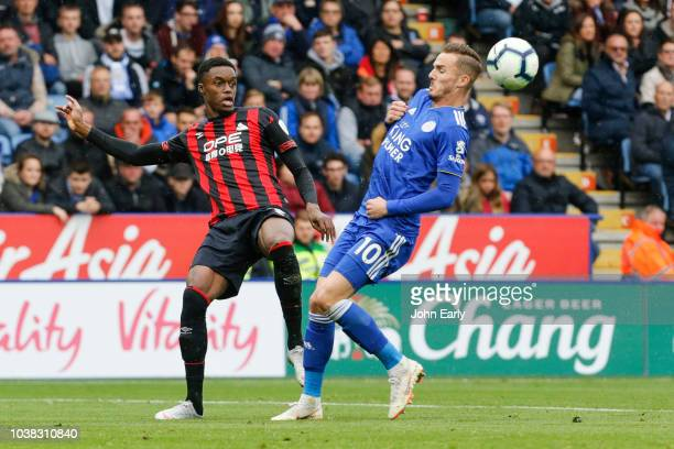 Adama Diakhaby of Huddersfield Town chips the ball past James Maddison of Leicester City during the Premier League match between Leicester City and...