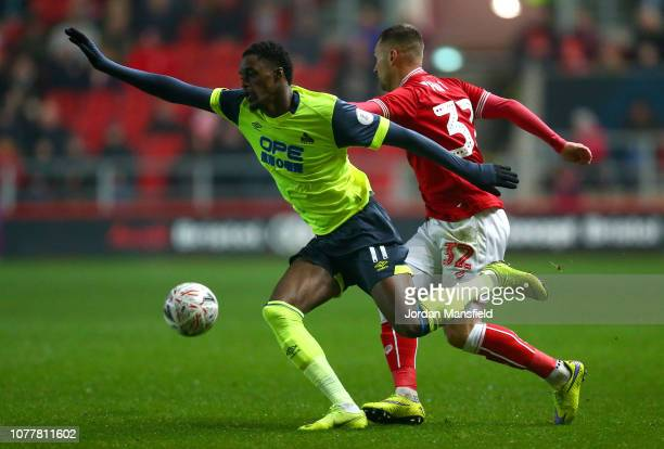 Adama Diakhaby of Huddersfield Town is challenged by Jack Hunt of Bristol City during the FA Cup Third Round match between Bristol City and...