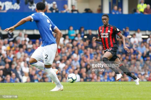 Adama Diakhaby of Huddersfield Town looks to take on Mason Holgate of Everton during the Premier League match between Everton FC and Huddersfield...