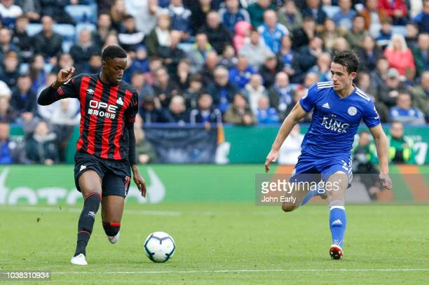 Adama Diakhaby of Huddersfield Town takes on Ben Chilwell of Leicester City during the Premier League match between Leicester City and Huddersfield...