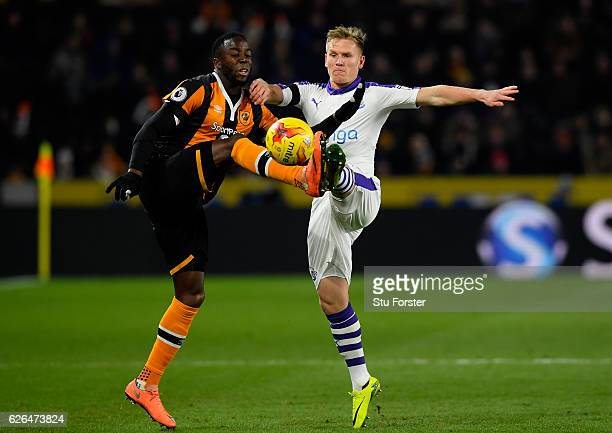 Adama Diomande of Hull City and Matt Ritchie of Newcastle United battle for the ball during the EFL Cup QuarterFinal match between Hull City and...