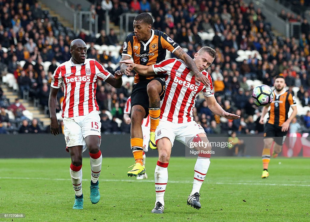 Adama Diomande of Hull City and Ryan Shawcross of Stoke City compete for the ball during the Premier League match between Hull City and Stoke City at the KCom Stadium on October 22, 2016 in Hull, England.