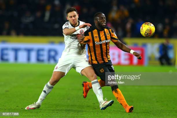 Adama Diomande of Hull City battles for control of the ball from George Baldock of Sheffield United during the Sky Bet Championship match between...