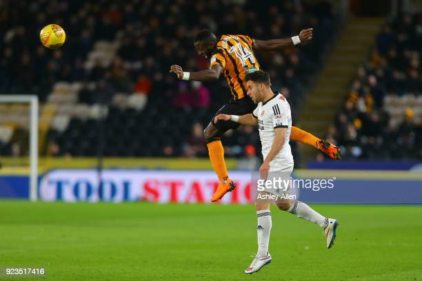 Adama Diomande of Hull City wins the ball from George Baldock of Sheffield United during the Sky Bet Championship match between Hull City and...
