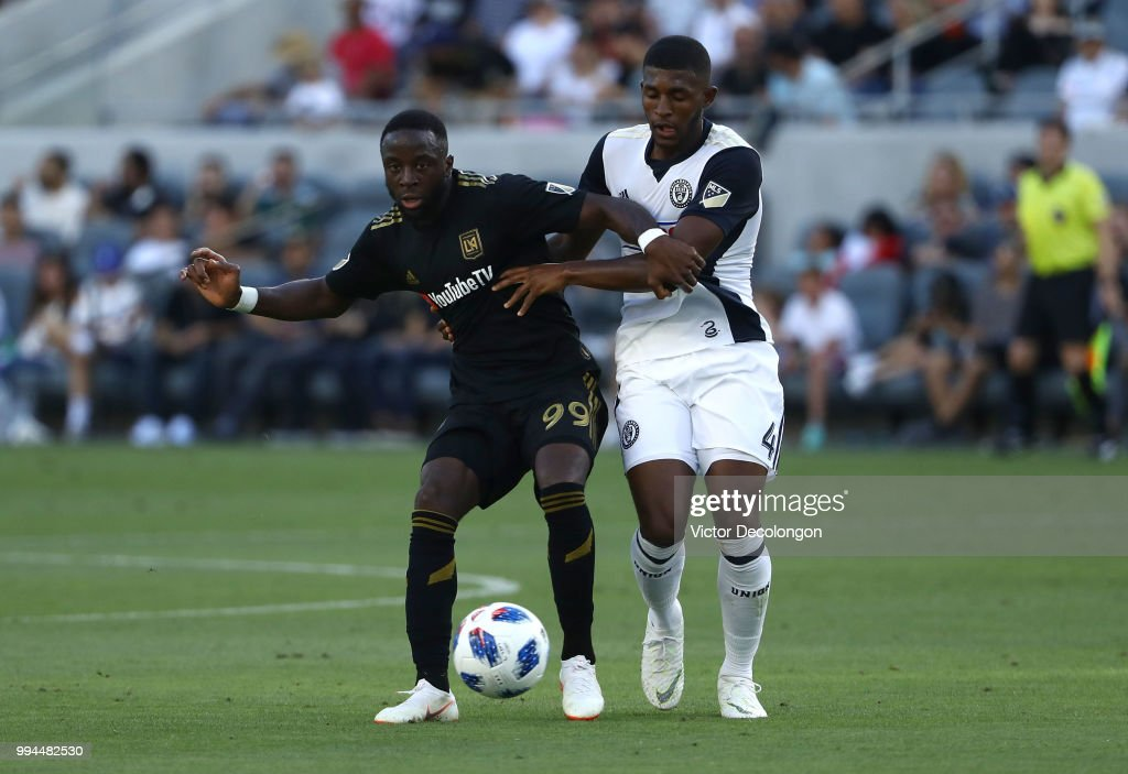 Adama Diomande #99 of Los Angeles FC passes the ball while under pressure from Mark McKenzie #4 of Philadelphia Union during the second half of their MLS match at Banc of California Stadium on June 30, 2018 in Los Angeles, California. Los Angeles FC defeated the Philadelphia Union 4-1.