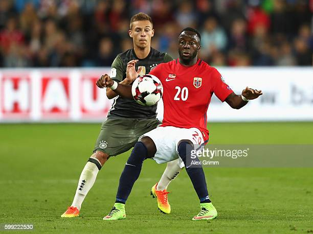 Adama Diomande of Norway is closed down by Joshua Kimmich of Germany during the 2018 FIFA World Cup Qualifier Group C match between Norway and...