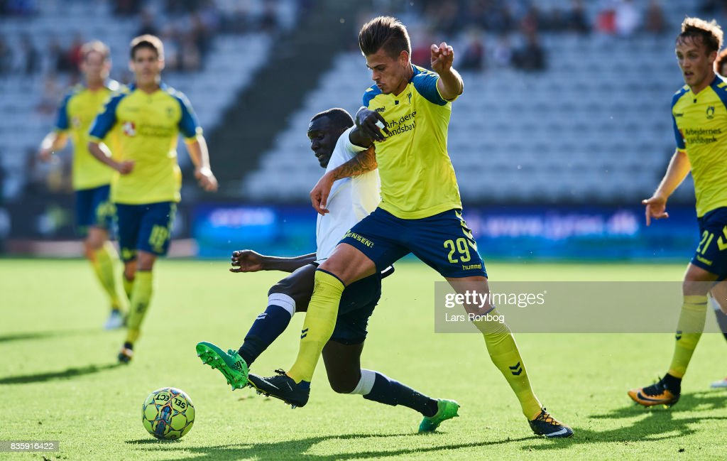 Adama Guira of AGF Aarhus and Jan Kliment of Brondby IF compete for the ball during the Danish Alka Superliga match between AGF Aarhus and Brondby IF at Ceres Park on August 20, 2017 in Aarhus, Denmark.