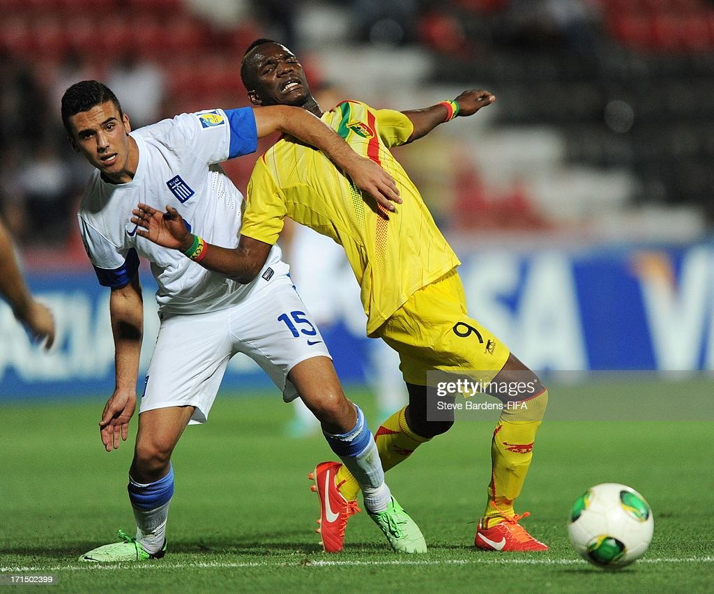 Adama Niane of Mali is pulled back by Dimitrios Kourmpelis of Greece during the FIFA U20 World Cup Group D match between Mali and Greece at Kamil Ocak Stadium on June 25, 2013 in Gaziantep, Turkey.