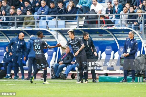 26 Adama Niane of Troyes 9 Hyunjun Suk of Troyes during the Ligue 1 match between Troyes AC and Olympique Lyonnais at Stade de l'Aube on October 22...