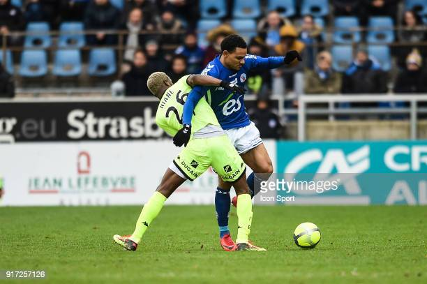 Adama Niane of Troyes and Kenny Lala of Strasbourg during the Ligue 1 match between Strasbourg and Troyes AC at on February 11 2018 in Strasbourg