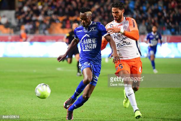 Adama Niane of Troyes and Pedro Mendes of Montpellier during the Ligue 1 match between ESTAC Troyes and Montpellier Herault SC at Stade de l'Aube on...