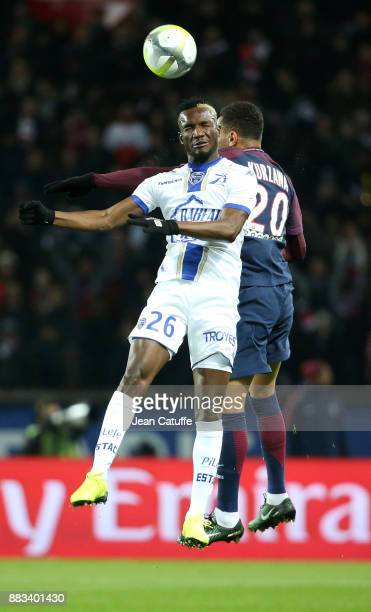 Adama Niane of Troyes Layvin Kursawa of PSG during the French Ligue 1 match between Paris Saint Germain and Troyes ESTAC at Parc des Princes on...