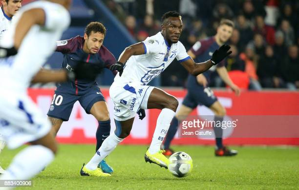 Adama Niane of Troyes Neymar Jr of PSG during the French Ligue 1 match between Paris Saint Germain and Troyes ESTAC at Parc des Princes on November...