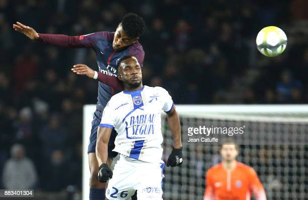 Adama Niane of Troyes Presnel Kimpembe of PSG during the French Ligue 1 match between Paris Saint Germain and Troyes ESTAC at Parc des Princes on...