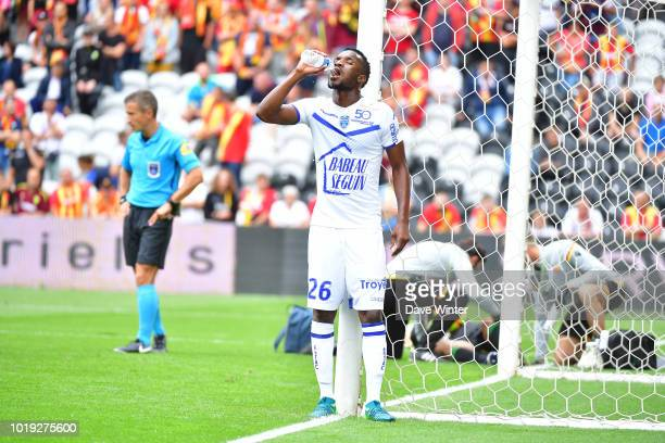 Adama Niane of Troyes stops for a drink during the French Ligue 2 match between RC Lens and Troyes at Stade BollaertDelelis on August 18 2018 in Lens...