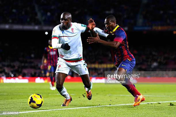 Adama of FC Barcelona duels for the ball with Foulquier of Granada CF during the La Liga match between FC Barcelona and Granda CF at Camp Nou on...