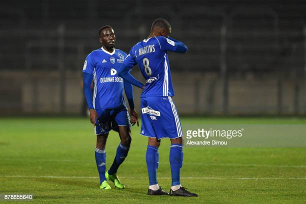 Adama Sarr and Christopher Martins Pereira of Bourg en Bresse during the Ligue 2 match between Nimes and Bourg en Bresse at Stade des Costieres on...