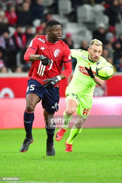 Adama Soumaoro of Lille and Flavien Tait of Angers during the Ligue 1 match between Lille OSC and Angers SCO at Stade Pierre Mauroy on February 24...