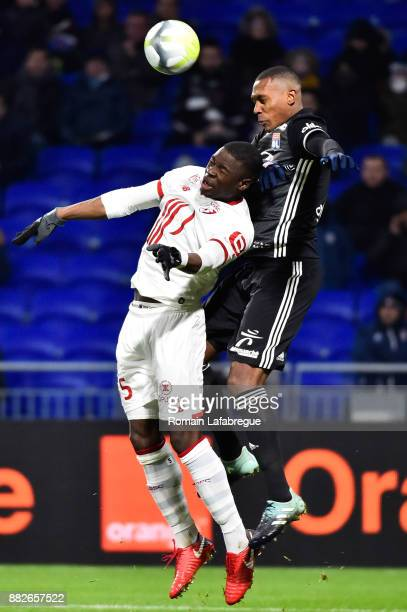 Adama Soumaoro of Lille and Marcelo Guedes Filho of Lyon during the Ligue 1 match between Olympique Lyonnais and Lille OSC at Parc Olympique on...