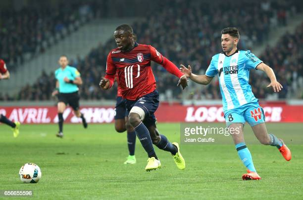 Adama Soumaoro of Lille and Morgan Sanson of OM in action during the Ligue 1 match between Lille OSC and Olympique de Marseille at Stade PierreMauroy...