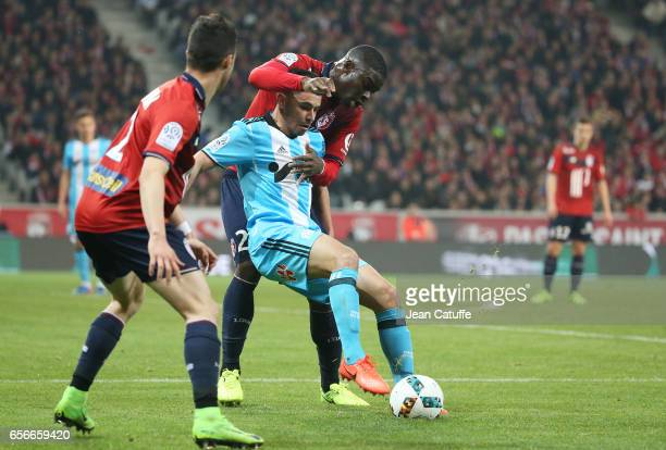 Adama Soumaoro of Lille and Morgan Sanson of OM in action during the French Ligue 1 match between Lille OSC and Olympique de Marseille at Stade...