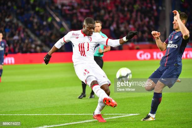 Adama Soumaoro of Lille and Yuri Berchiche of PSG during the Ligue 1 match between Paris Saint Germain and Lille OSC at Parc des Princes on December...