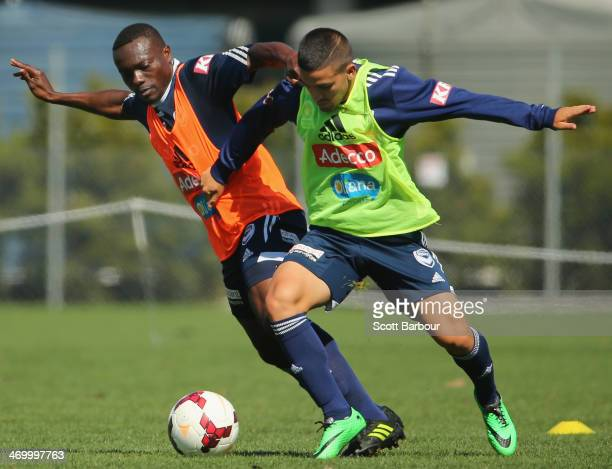 Adama Traoré and Christopher Cristaldo of the Victory compete for the ball during a Melbourne Victory ALeague training session at Gosch's Paddock on...
