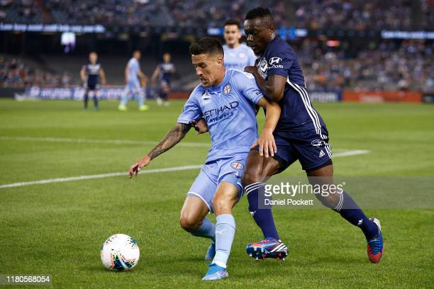 Adama Traoré of the Victory and Marcelo Cabrera of Melbourne City contest the ball during the round one ALeague match between the Melbourne Victory...