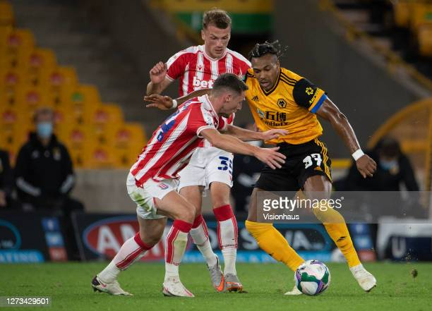 Adama Traoré of Wolverhampton Wanderers and Jordan Thompson and Josh Tymon of Stoke City during the Carabao Cup second round match between...