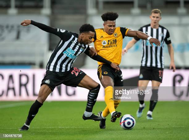 Adama Traoré of Wolverhampton Wanderers and Joseph Willock of Newcastle United in action during the Premier League match between Newcastle United and...