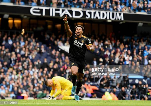 Adama Traore celebrates after scoring a goal to make it 01 during the Premier League match between Manchester City and Wolverhampton Wanderers at...