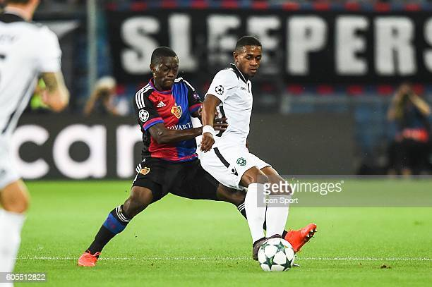 Adama Traore of Bale and Virgil Misidjan of Ludogorets during the Uefa Champions League match between Basel Fc and PFC Ludogorets Razgrad on...
