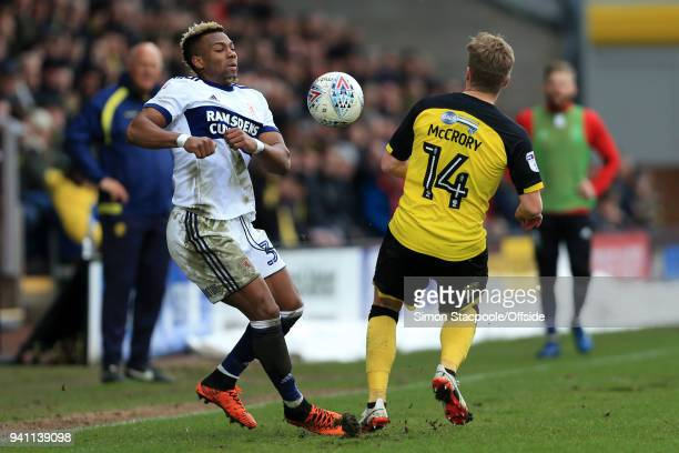 Adama Traore of Boro battles with Damien McCrory of Burton during the Sky Bet Championship match between Burton Albion and Middlesbrough at the...
