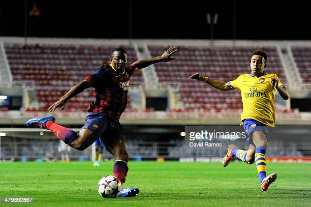Adama Traore of FC Barcelona assists his teammate Wilfrid Kaptoum to score his team's third goal during the UEFA Youth League Quarter FInal match...