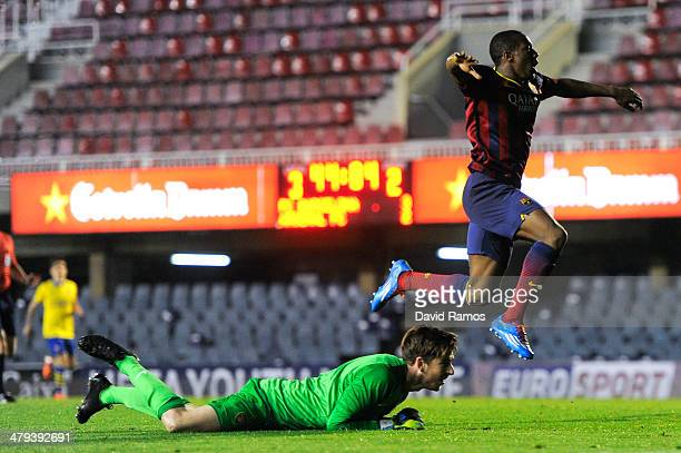 Adama Traore of FC Barcelona celebrates past Josh Vickers of Arsenal after scoring his team's fourth goal during the UEFA Youth League Quarter FInal...