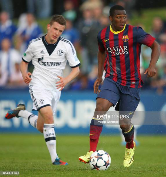 Adama Traore of FC Barcelona competes for the ball with Miles Mueller of FC Schalke 04 during the UEFA Youth League Semi Final match between Schalke...