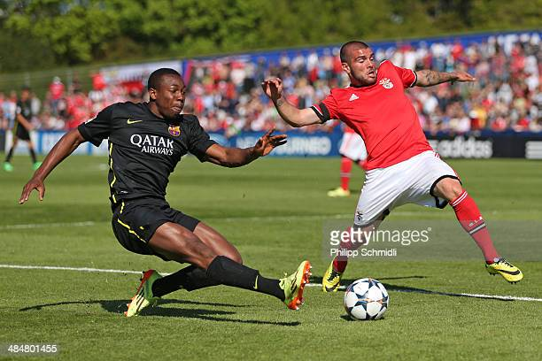 Adama Traore of FC Barcelona competes for the ball with Rebocho of SL Benfica during the UEFA Youth League Final match between Benfica Lisbon and FC...