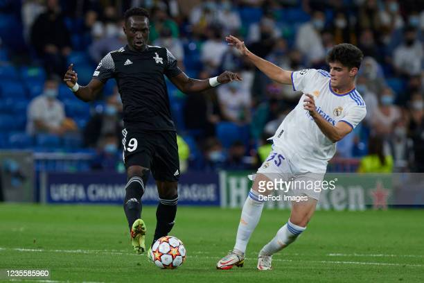 Adama Traore of FC Sheriff and Miguel Gutierrez of Real Madrid CF battle for the ball during the UEFA Champions League group D match between Real...