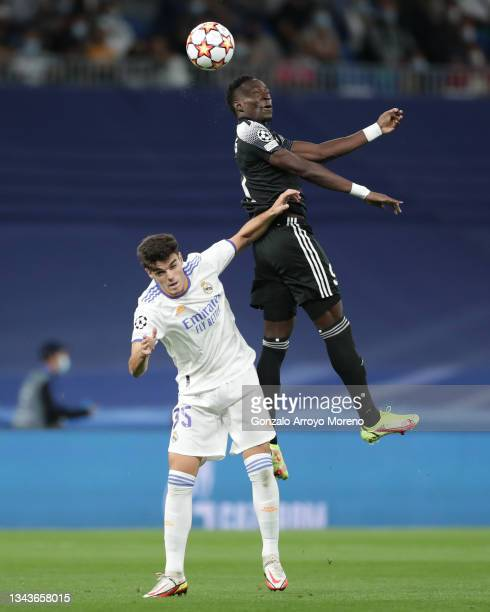 Adama Traore of FC Sheriff Tiraspol wins the header before Miguel Gutierrez of Real Madrid CF during the UEFA Champions League group D match between...