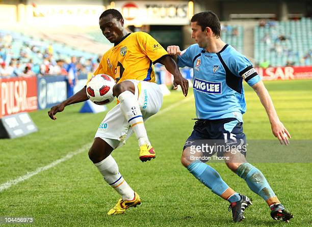 Adama Traore of Gold Coast competes with Terry McFlynn of Sydney during the round eight ALeague match between Sydney FC and Gold Coast United at...