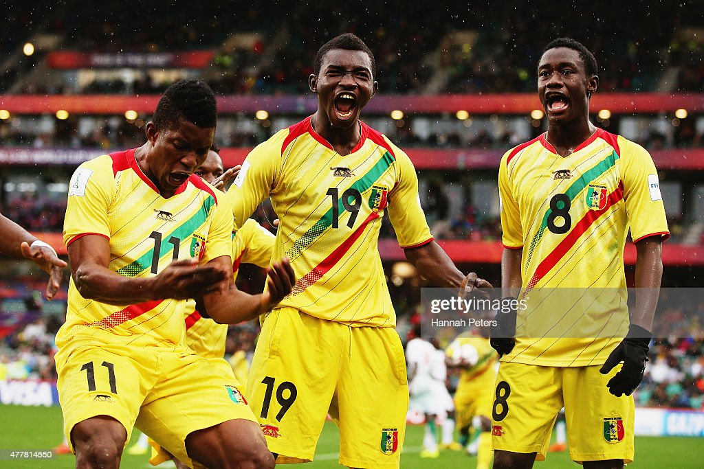 Adama Traore of Mali celebrates after scoring a goal with Malick Toure of Mali and Diadie Samassekou of Mali during the FIFA U-20 World Cup Third Place Play-off match between Senegal and Mali at North Harbour Stadium on June 20, 2015 in Auckland, New Zealand.