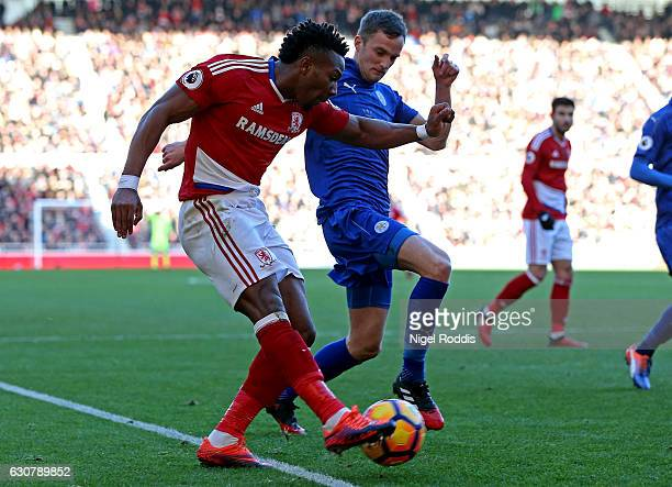 Adama Traore of Middlesbrough attempts to cross while Andy King of Leicester City attempts to block during the Premier League match between...