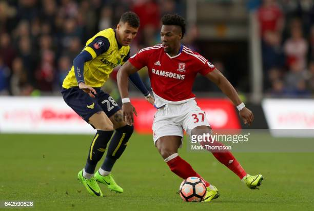 Adama Traore of Middlesbrough attempts to take the ball past Marvin Johnson of Oxford United during The Emirates FA Cup Fifth Round match between...