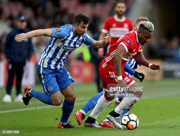 Adama Traore of Middlesbrough is challenged by Markus Suttner of Brighton and Hove Albion during The Emirates FA Cup Fourth Round match between...