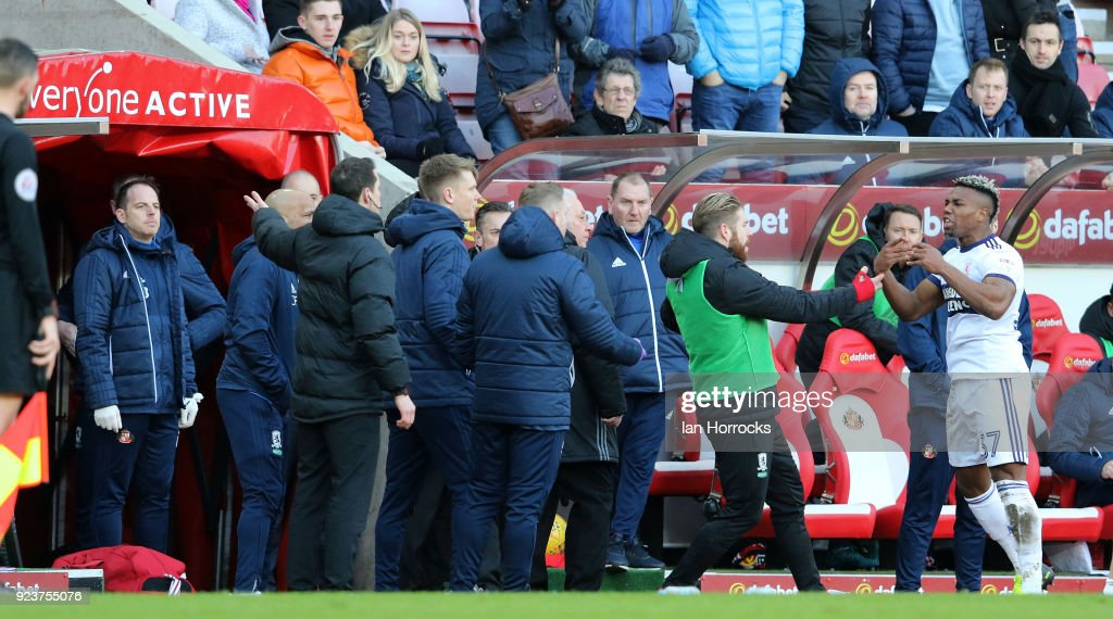 Adama Traore (R) of Middlesbrough is sent off and argues with the fourth official during the Sky Bet Championship match between Sunderland and Middlesbrough at Stadium of Light on February 24, 2018 in Sunderland, England.